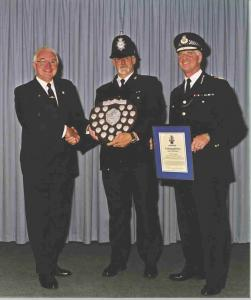 Me with the Chief Constable of Devon & Cornwall Sir John Evans presenting my Charity Shield to PC Bob Bigland of Newton Abbot for outstanding work to help young people in his area 2001